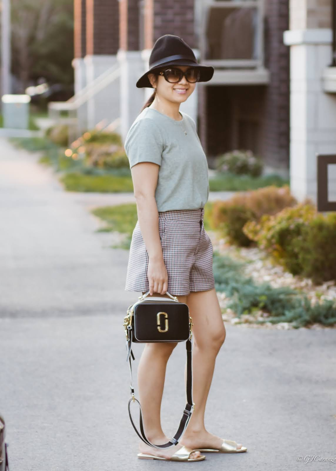 Zara plaid shorts_Walmart green t-shirt_Walmart slides_Marc Jacobs Sure Shot Bag_HM hat_Gucci Sunglasses | Petite Fashion