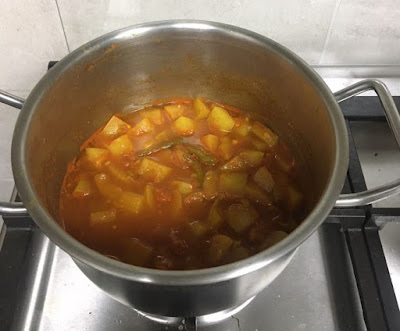 cooked lauki and tomatoes with water reduced