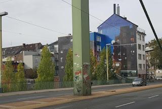 Pac-Man ghost sticker street art by Pdot in Düsseldorf, Germany