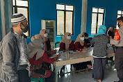 Kapolsek Tambelang Pimpin Kegiatan Vaksinasi Gerai 64 Bagi Masyarakat Desa Sukamantri
