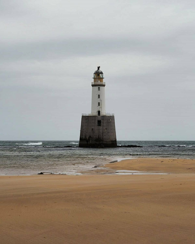 Rattray head lighthouse surrounded by sea water