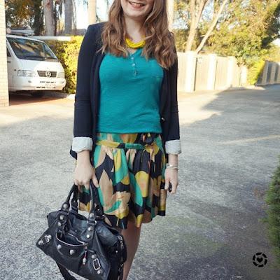 awayfromblue instagram teal henley, jersey blazer, printed silk skirt outfit