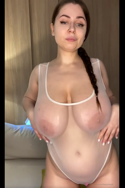sexy hot woman with huge tits wet transparent bodysuit