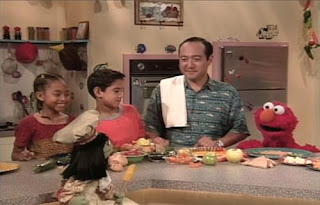 Alan, Elmo and Jean the Genie are in the kitchen. Sesame Street Elmo's Magic Cookbook
