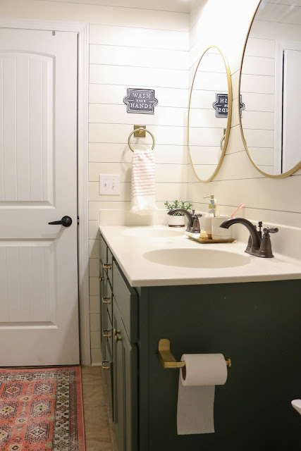 basic builder bathroom updated into a pretty kid-friendly bath with shiplap walls