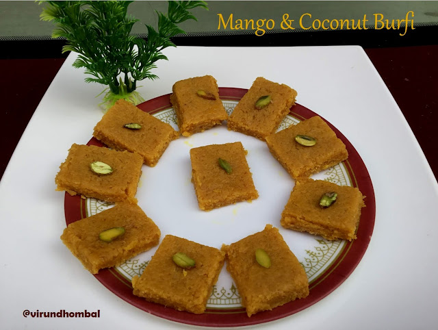 Mango and Coconut Burfi recipe - delicious sweet prepared with mango pulp, coconut, milk powder and sugar. Easy and tasty burfi within 30 minutes. Mango recipes - Sweet with mangoes.