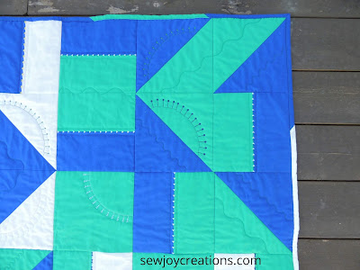 multi fabric binding baby quilt