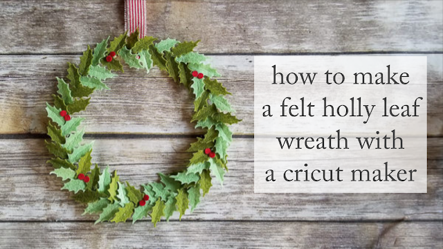felt holly leaf wreath with red stripe ribbon