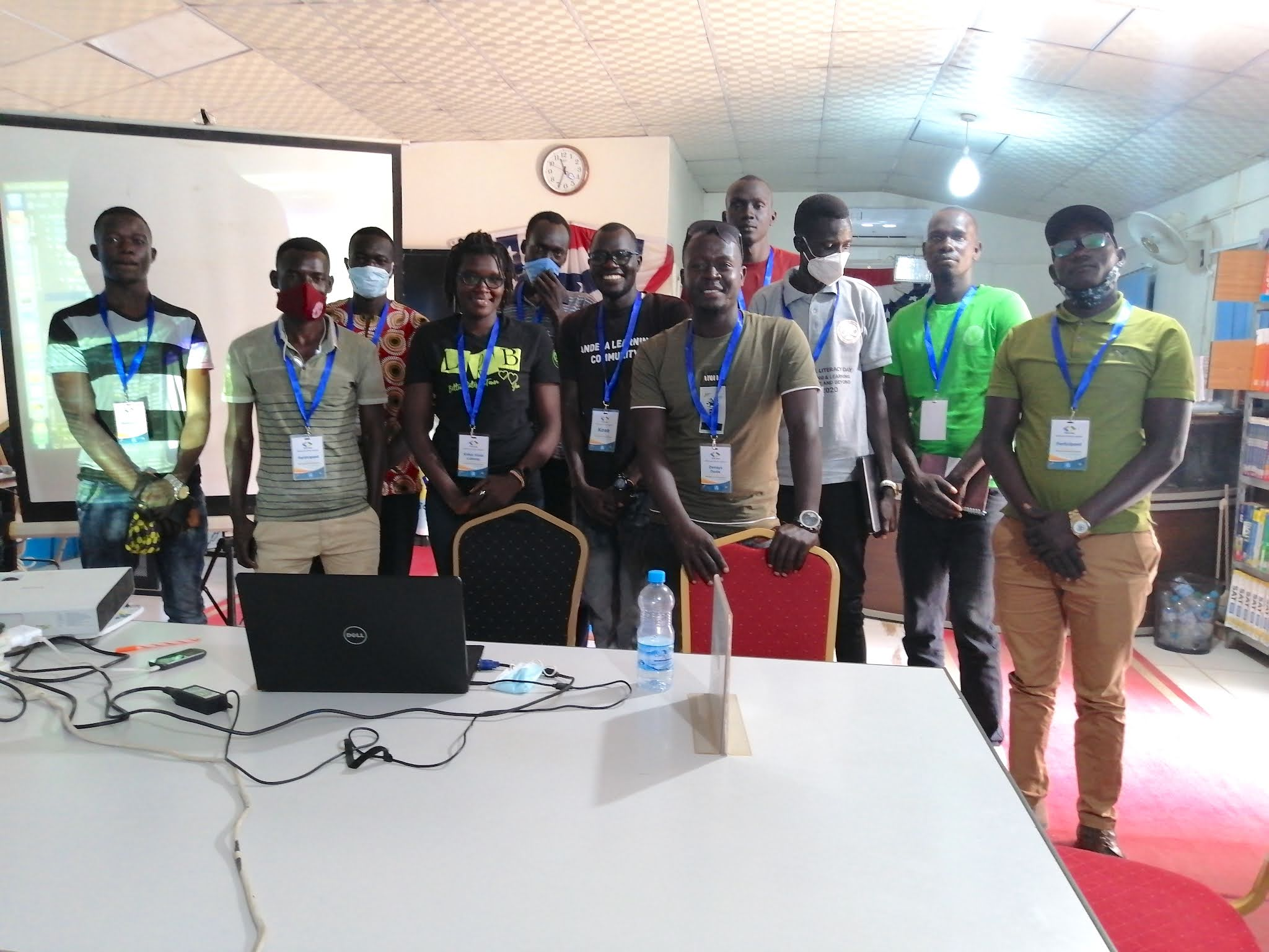 Kose standing with 10 members at GDG Juba meetup