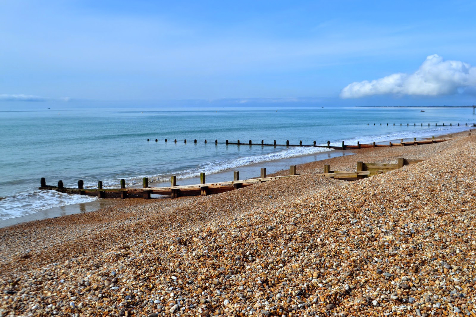 A shingle beach leading into beautiful blue sea on the english channel