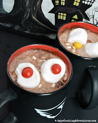 mugs of hot chocolate with floating eyes