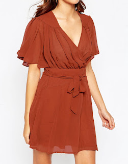 http://www.asos.com/asos-petite/asos-petite-kimono-flippy-dress-with-stitch-shoulder-detail/prod/pgeproduct.aspx?iid=5368254&clr=Rust&SearchQuery=flippy+dress&pgesize=20&pge=0&totalstyles=20&gridsize=3&gridrow=6&gridcolumn=1