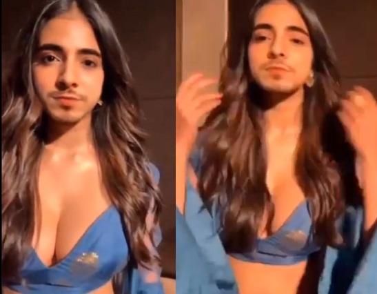 المتشبه بالنساء الاماراتي بدر خلف يستعرض صدره بعد اختبار الحمل   موقع عناكب