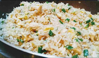 Cooked chicken fried rice in a non stick skillet