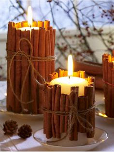 pretty Christmas decoration with candles surrender by cinnamon sticks