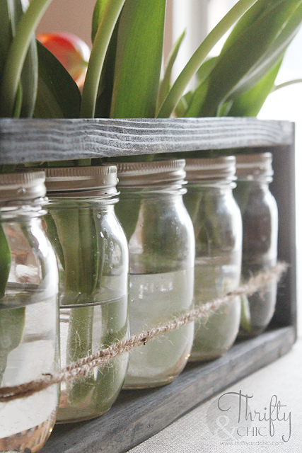 DIY Mason jar and wood vase centerpiece. Perfect for spring decor and wedding decor!