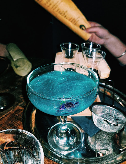 blue sparkly potion cocktail