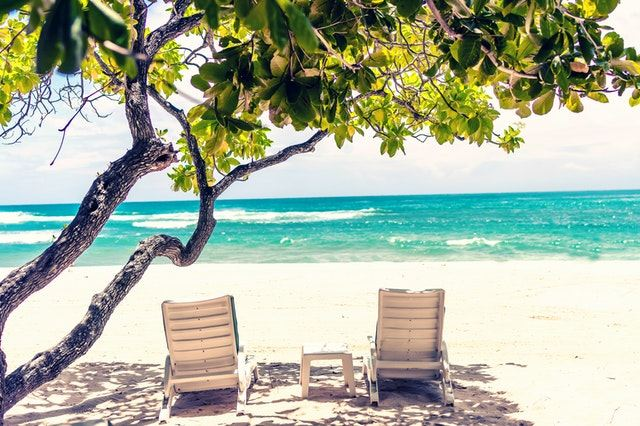 Loungers on a beach in the Caribbean