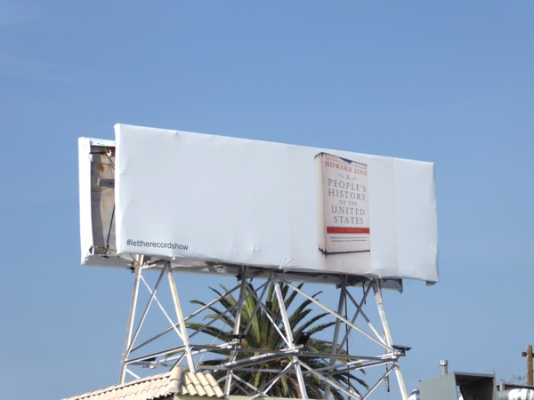 Peoples History of United States book Let Record Show billboard