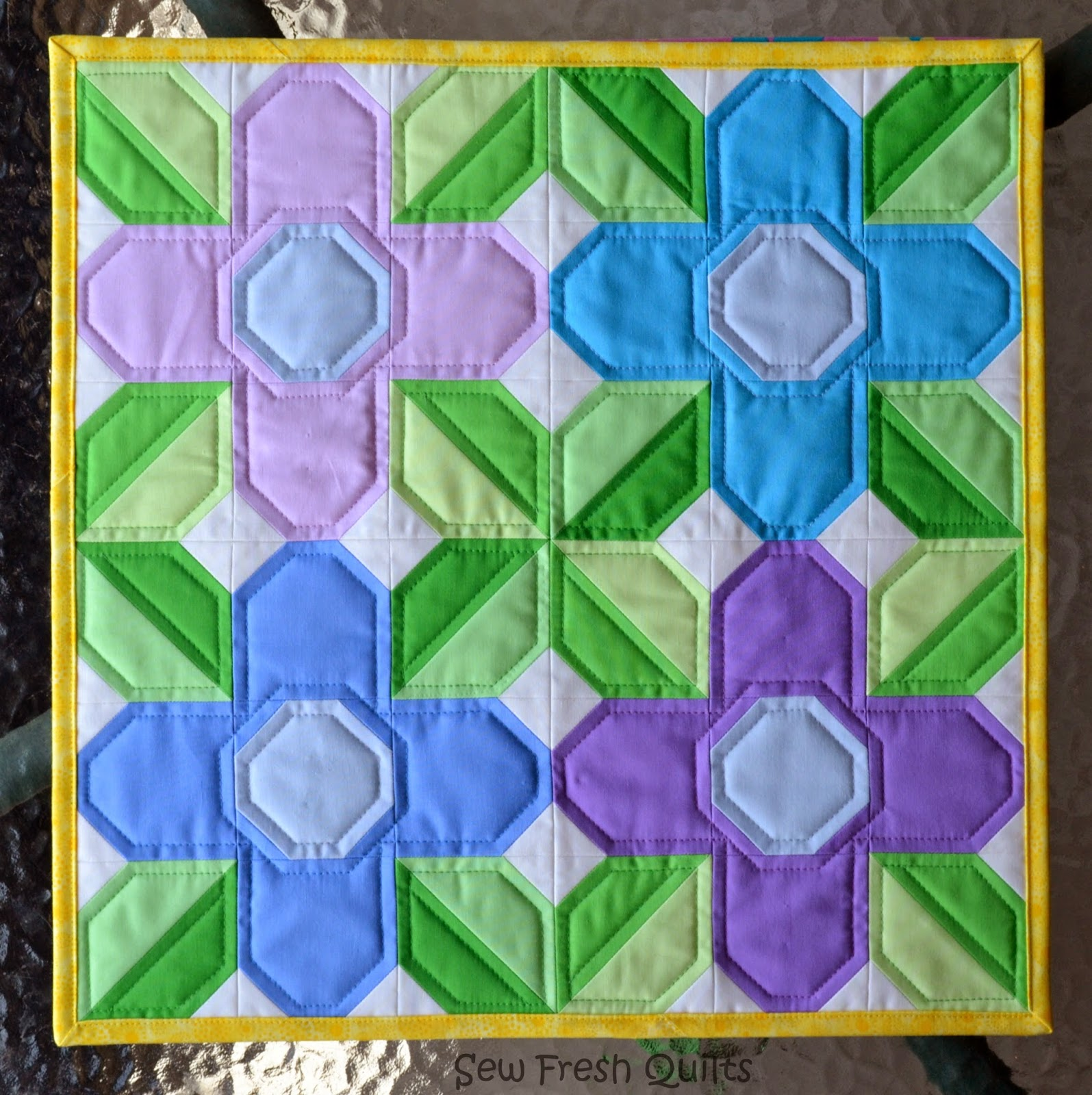 http://sewfreshquilts.blogspot.ca/2014/05/pretty-posy-free-quilt-block-tutorial.html