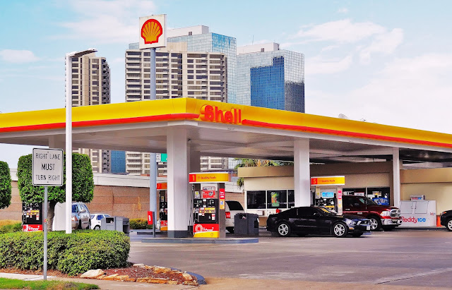 Shell Station on Southwest Freeway with Greenway Plaza office Towers in background