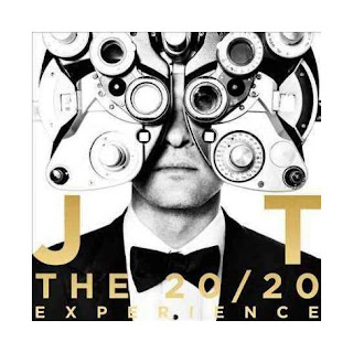 The cover for Justin Timberlake's album called The 20/20 Experience. It is black and white with gold lettering and he is standing behind eye testing equipment.