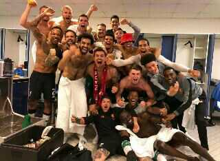 Liverpool Players Celebrating After Qualifying For Final Of Champions League