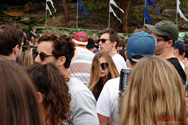 Hair flick, and a gap in the crowd. Harbour Life Music Festival Sydney 2016. Photographed by Kent Johnson for Street Fashion Sydney.