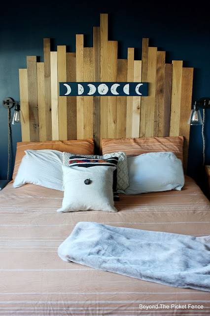 Reclaimed Wood Headboard and Moon Sign for a Rustic Boho Bedroom