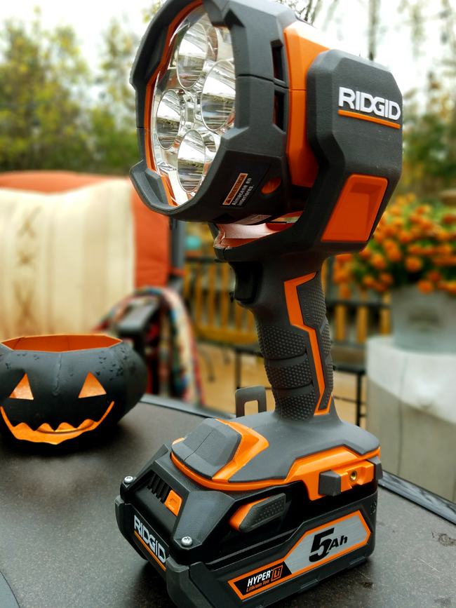 Ridgid power light cannon in backyard wit pumpkin planter