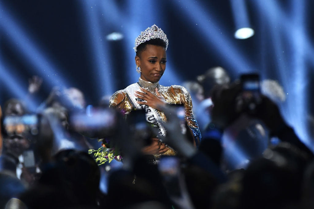 Miss Universe 2019 Zozibini Tunzi, of South Africa, waves onstage at the 2019 Miss Universe Pageant at Tyler Perry Studios on December 08, 2019 in Atlanta, Georgia. (Photo by Paras Griffin/Getty Images)