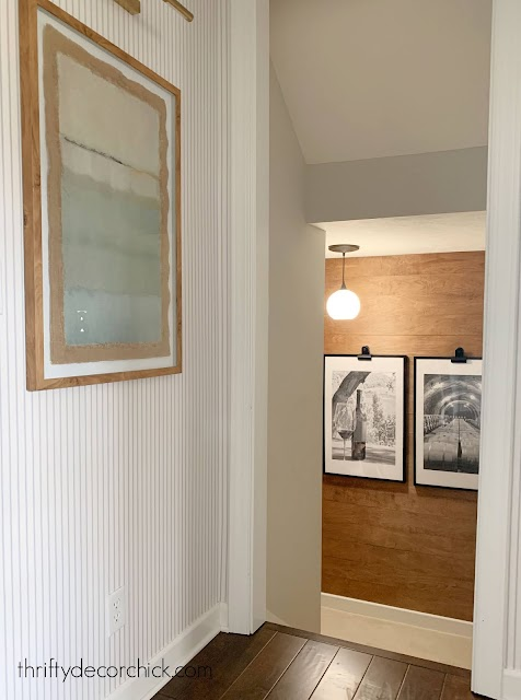 foyer with wood wall on landing
