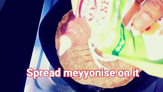 image of spreading meyyonaise on roti