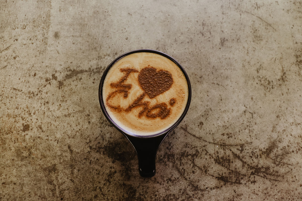 Chai latte with powdered pattern saying 'I love chai'