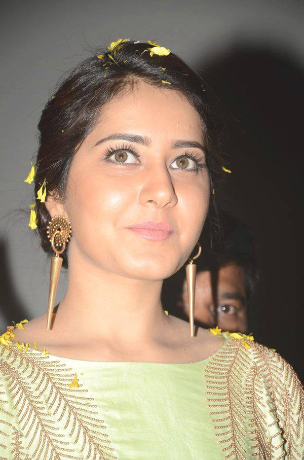 Rashi Khanna Stills At Movie Function In Green Dress