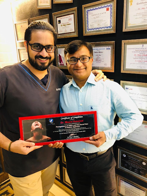 Dr. Moez Khakiani awarding certificate to Dr. Bharat Katarmal for Comprehensive training on Management of TMD's and Orofacial Pain: A Holistic Approach at Mumbai