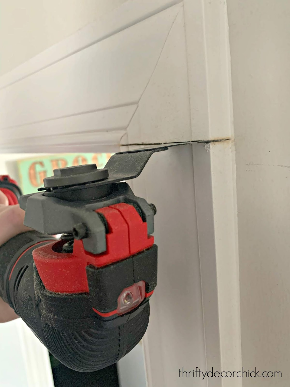 Cutting door trim on the wall