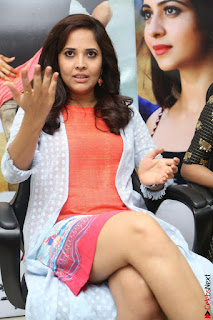 Actress Anasuya Bharadwaj in Orange Short Dress Glam Pics at Winner Movie Press Meet February 2017 (17).JPG