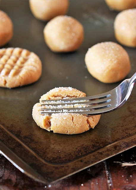 Using Fork to Make Flourless Peanut Butter Cookies Cross-Hatch Pattern Image