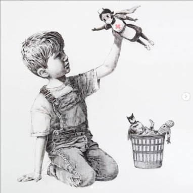 Banksy NHS Superheroes Child playing with nurse doll pretending it's flying