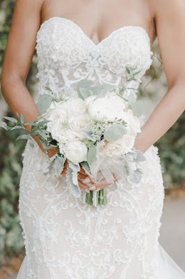white bridal bouquet and pnina tornai wedding dress