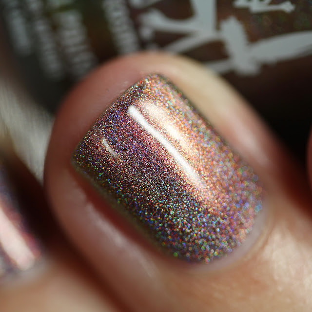 Bronze linear holographic nail polish with copper shimmer