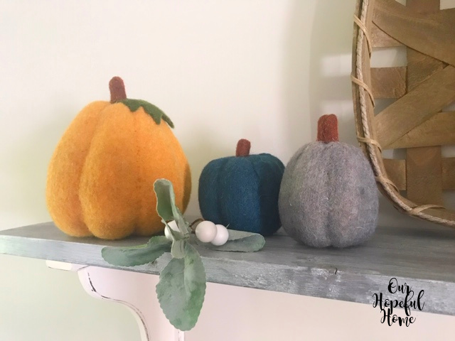 gold blue gray felted pumpkin greenery white berries