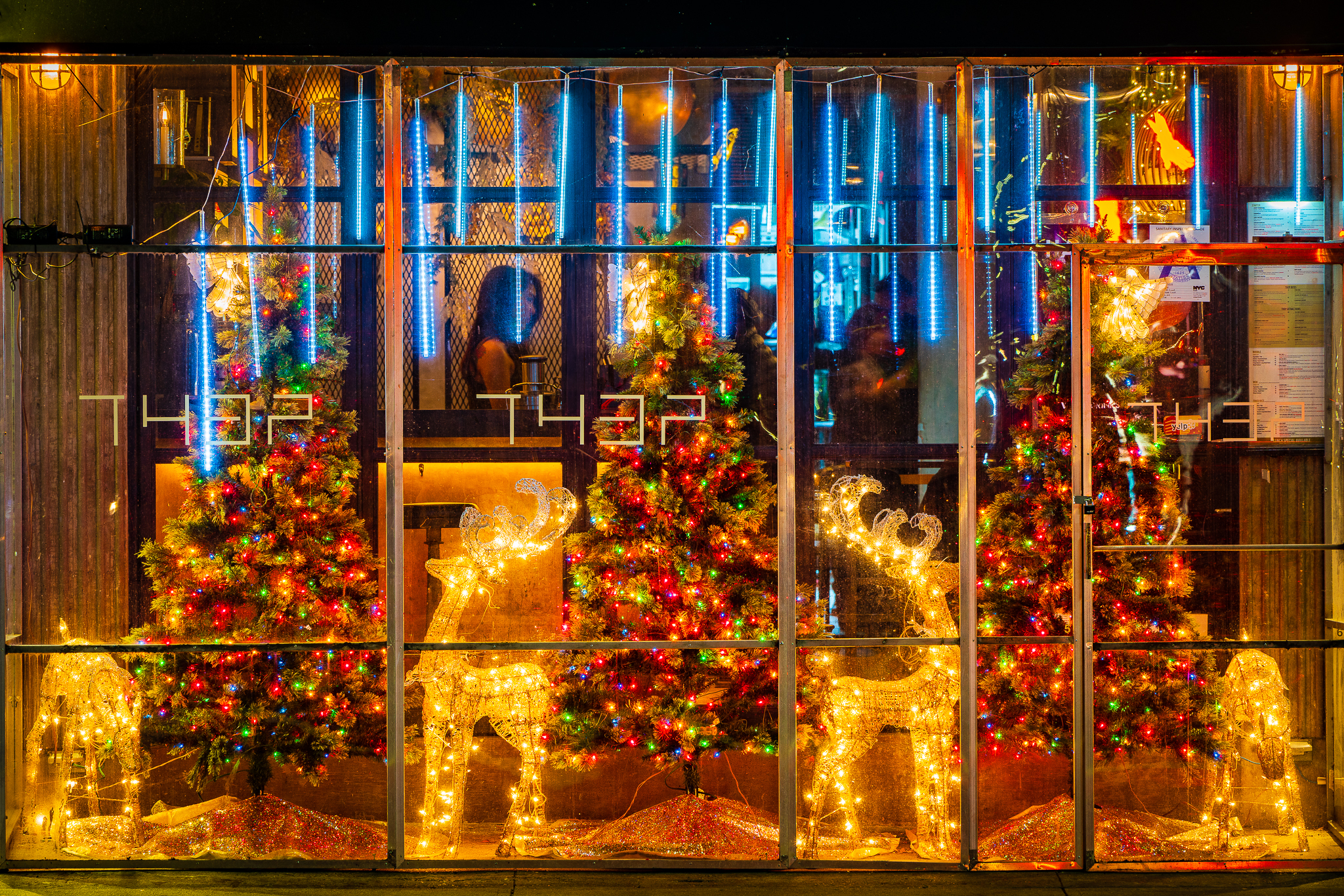 a photo of a new york thai restaurant with christmas decorations