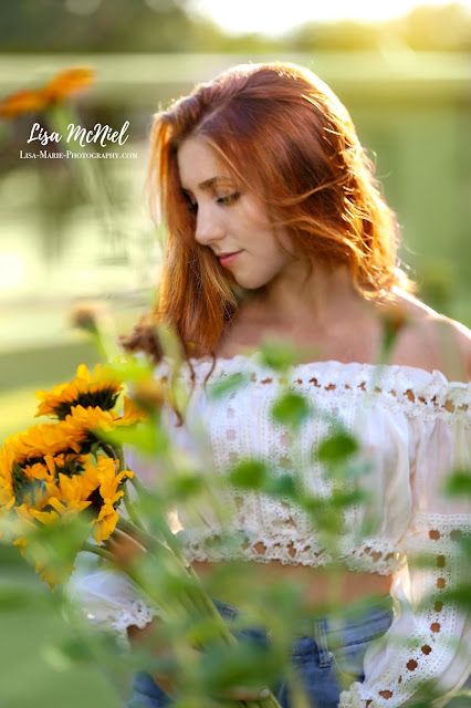 red haired teen looking at flowers