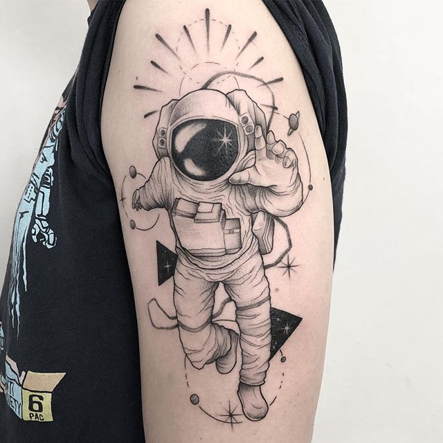 small astronaut tattoo for sleeve