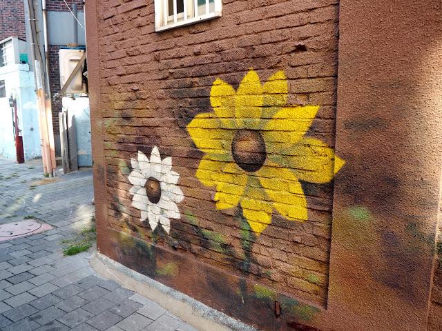 Sunflower street art in the Haenggung-dong mural village in Suwon, South Korea