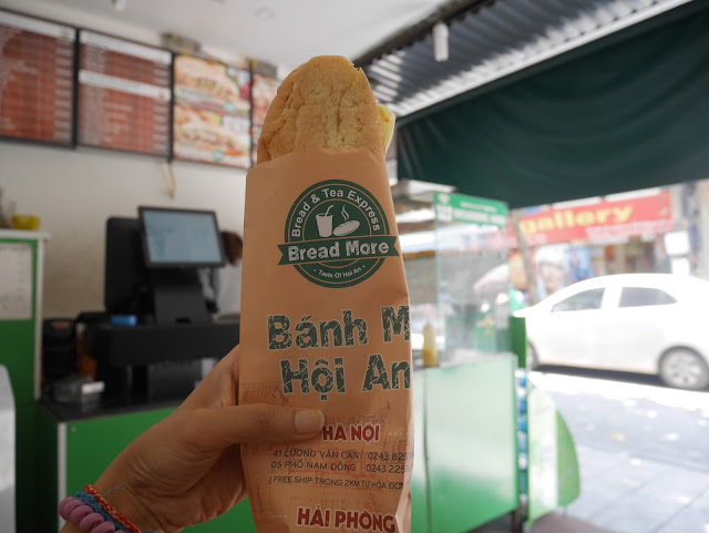Warm and crispy Banh Mi in my hand!