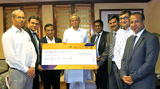 photo of L&T officials handing over the cheque towards flood relief to Hon'ble Chief Minister of Rajasthan Shri Ashok Gehlot.