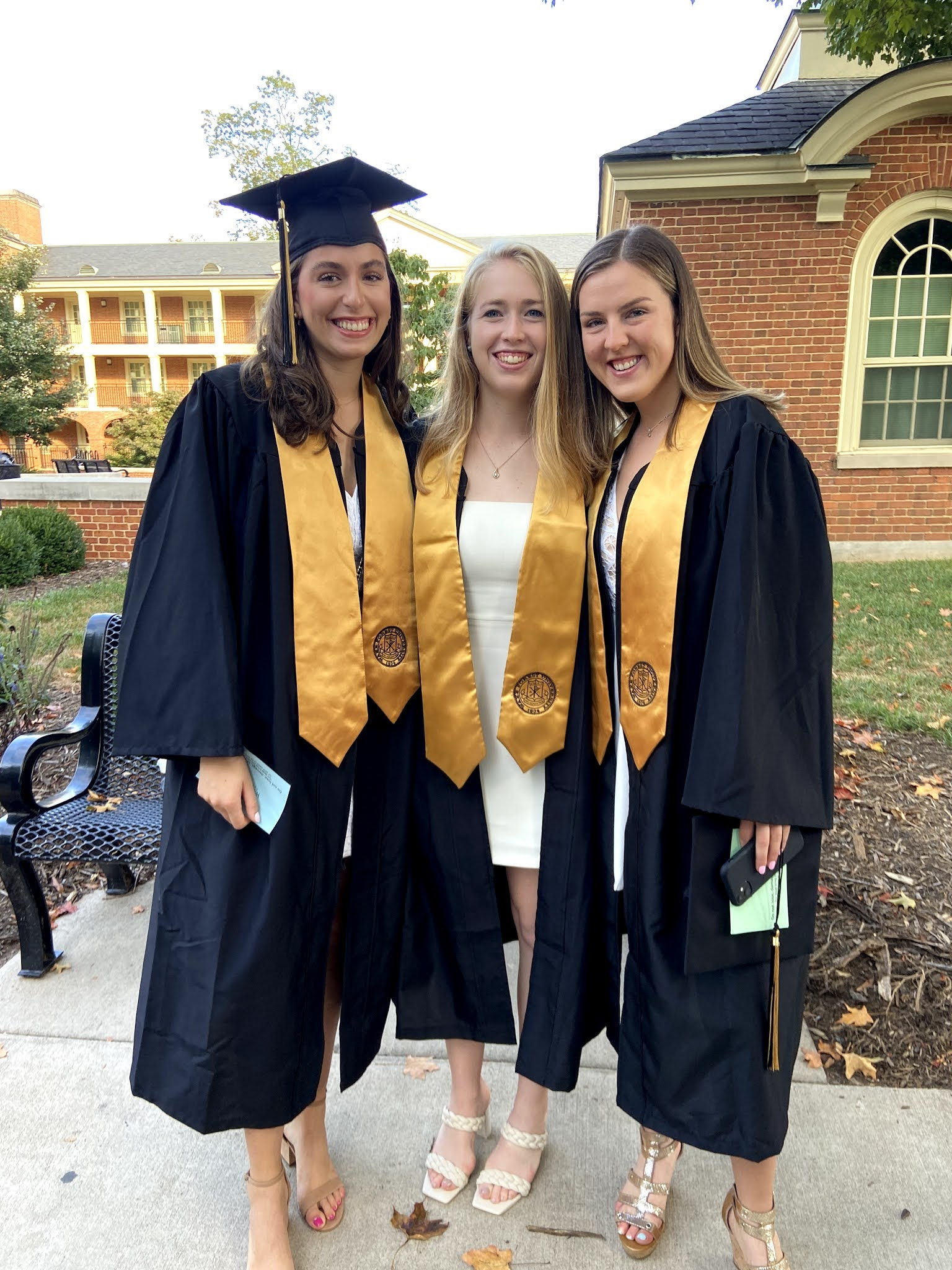 friends, cap and gown